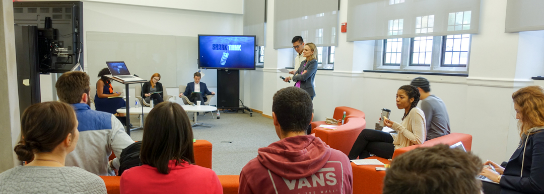 Undergraduate students present pair projects to their peers in Heather Klemann's course