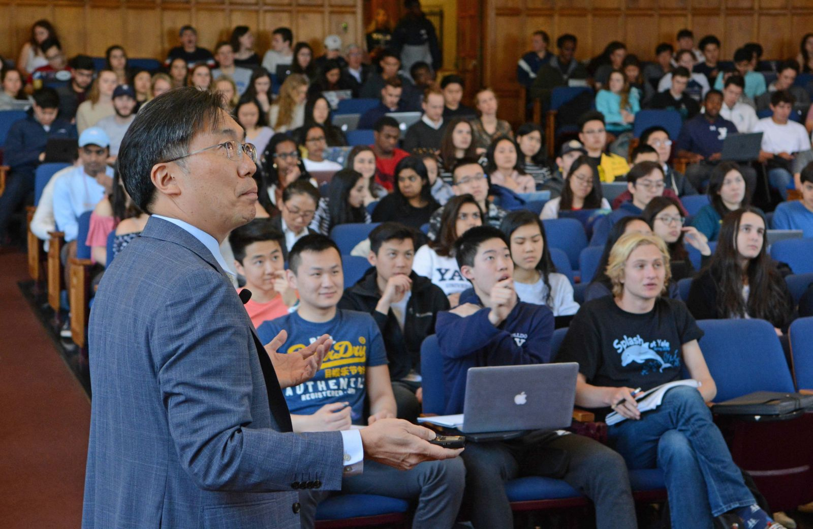 Dean Marvin Chun teaching his course in a lecture space with students