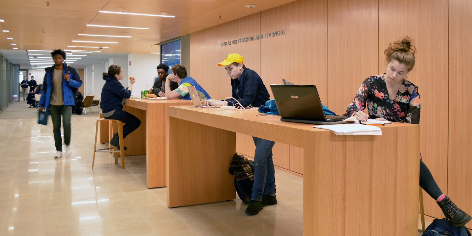 The Learning Commons in the Poorvu Center with a group of students working on the touchdown desks.