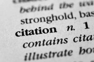 A dictionary with the word citation highlighted