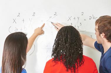 Three students work to solve math problem sets