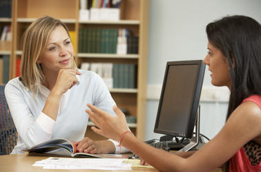 Two women meet in an academic setting to discuss a subject