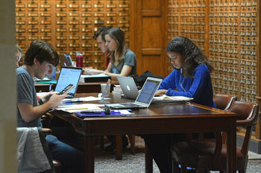 Students Studying in Sterling Memorial Library