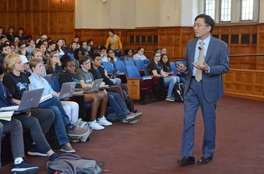 Dean Marvin Chun teaching in front of a room of students