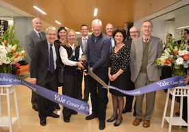 Pictured at the ribbon-cutting ceremony for the new home of the Center for Teaching and Learning are (from left) School of Management Dean Ted Snyder, President Peter Salovey, Executive Director Jenny Frederick, Signe Ostby, Executive Director Lucas Swineford, Scott Cook, Deputy Provost for Teaching and Learning Scott Strobel, Faculty of Arts & Sciences Dean Tamar Gendler (FAS), School of Music Dean Robert Blocker, and Provost Ben Polak. (Photo by Michael Marsland)